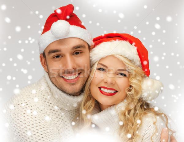 family couple in sweaters and santa's hats Stock photo © dolgachov