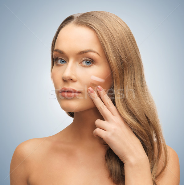 woman applying foundation Stock photo © dolgachov