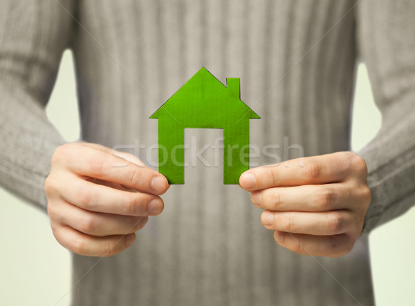 Stock photo: hands holding green house