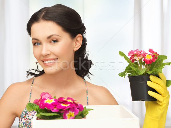 housewife with flower in box and pot Stock photo © dolgachov