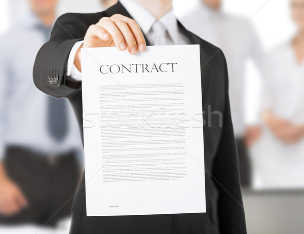 man with contract Stock photo © dolgachov