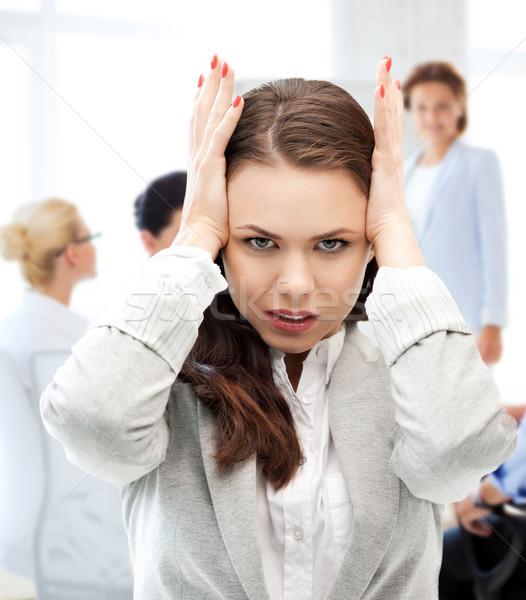 stressed businesswoman in office Stock photo © dolgachov