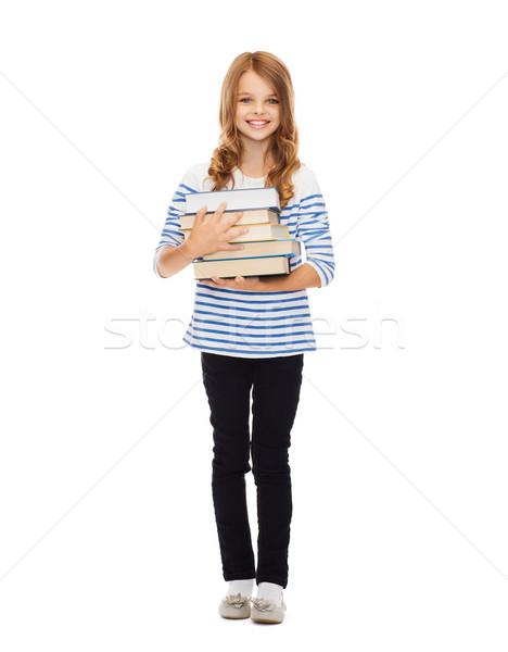 Kicsi diák lány sok könyvek oktatás Stock fotó © dolgachov