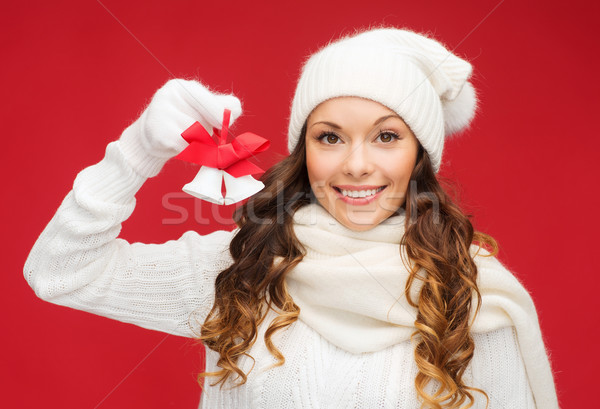 smiling woman in mittens and hat with jingle bells Stock photo © dolgachov