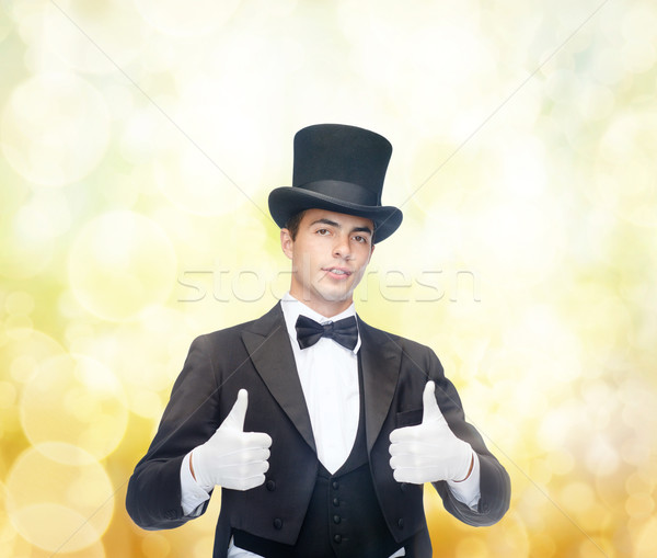 magician in top hat showing thumbs up Stock photo © dolgachov