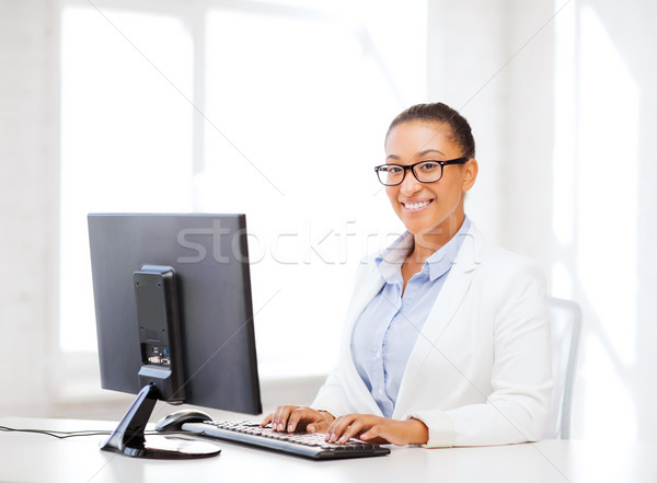 african businesswoman with computer in office Stock photo © dolgachov