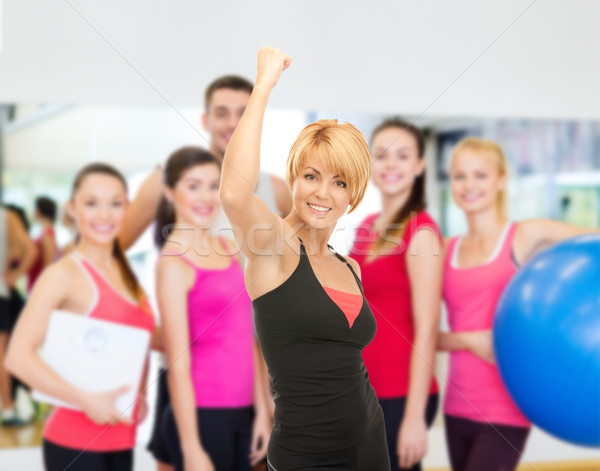 female trainer with expression of triumph Stock photo © dolgachov