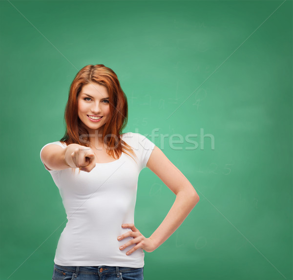 teenager in blank white t-shirt pointing at you Stock photo © dolgachov