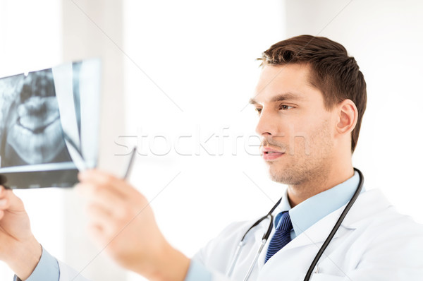male doctor or dentist looking at x-ray Stock photo © dolgachov