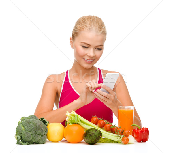 woman with vegetables pointing at smartphone Stock photo © dolgachov
