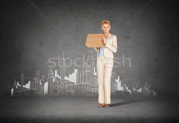 businesswoman delivering cardboard box Stock photo © dolgachov