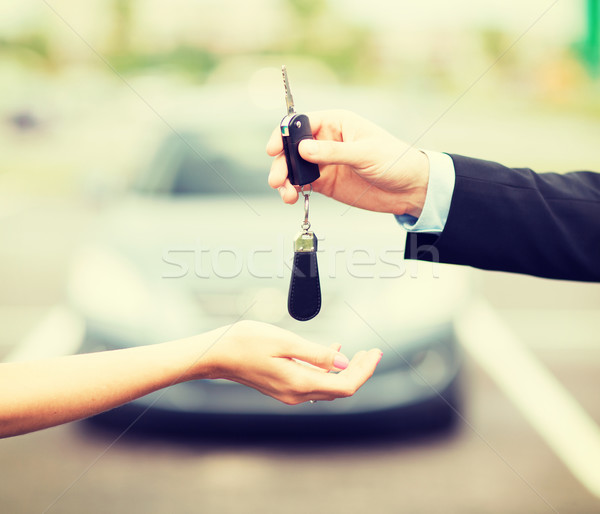 customer and salesman with car key Stock photo © dolgachov