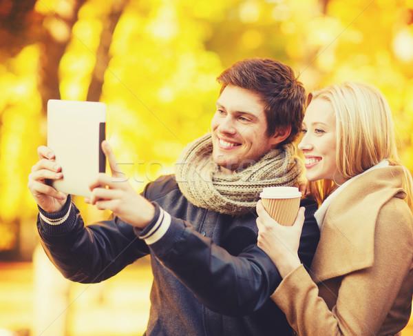 couple taking photo picture autumn park Stock photo © dolgachov