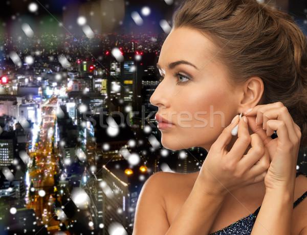 Közelkép nő visel fülbevalók emberek ünnepek Stock fotó © dolgachov
