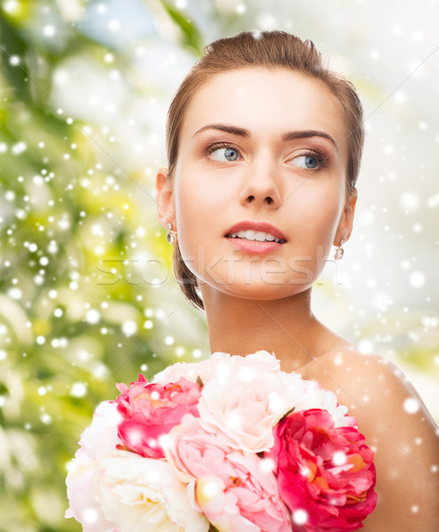 woman with diamond earrings, ring and flower Stock photo © dolgachov