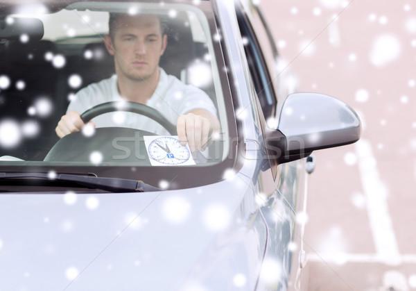 man driving car and putting parking clock Stock photo © dolgachov