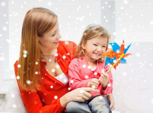 mother and daughter with pinwheel Stock photo © dolgachov