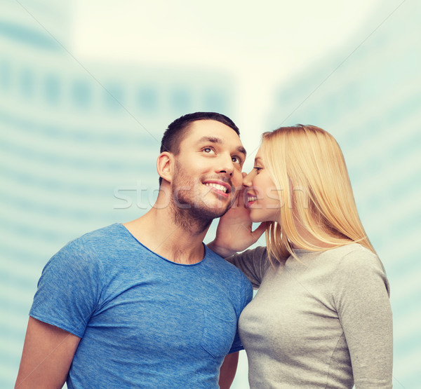 smiling girlfriend telling boyfriend secret Stock photo © dolgachov