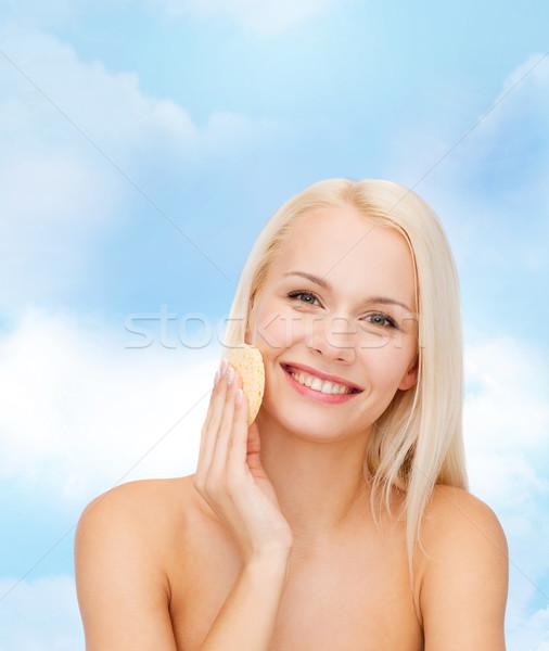 beautiful woman with sponge Stock photo © dolgachov