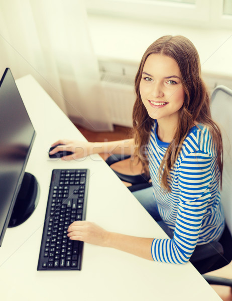 Stock photo: dreaming teenage girl with computer at home