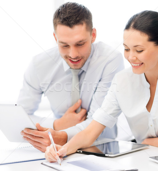 business team working with tablet pcs Stock photo © dolgachov