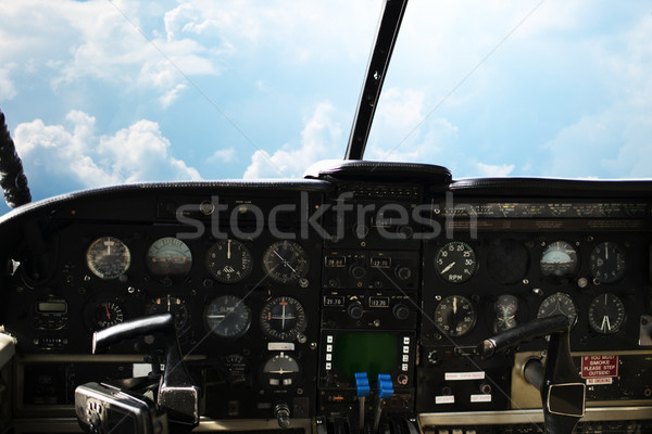 dashboard in airplane cockpit and view of sky Stock photo © dolgachov