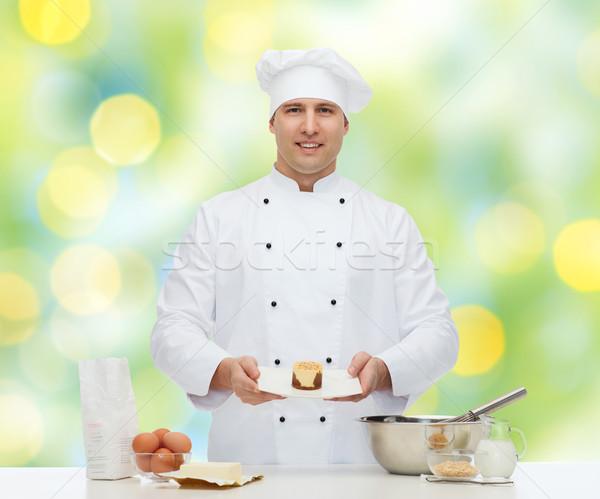happy male chef cook baking Stock photo © dolgachov