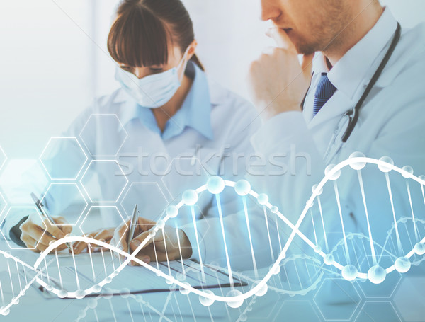 doctor and nurse writing dna test report Stock photo © dolgachov