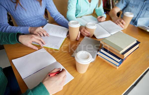 close up of hands with books writing to notebooks Stock photo © dolgachov