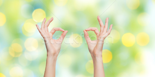 woman hands showing ok sign over blue sky Stock photo © dolgachov