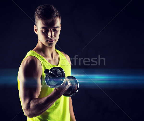 Jeune homme biceps sport bodybuilding formation Photo stock © dolgachov