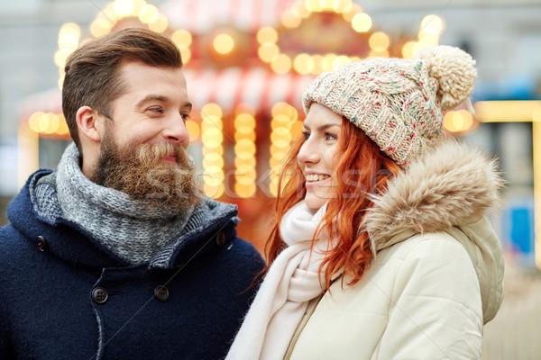 happy couple walking in old town Stock photo © dolgachov