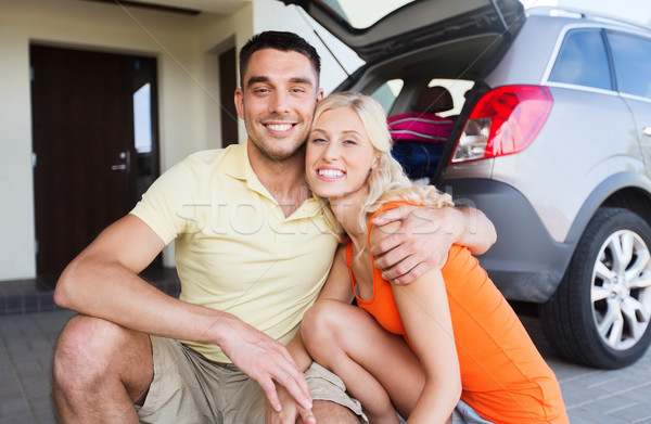 happy couple hugging at home car parking space Stock photo © dolgachov