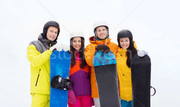 happy friends in helmets with snowboards outdoors Stock photo © dolgachov