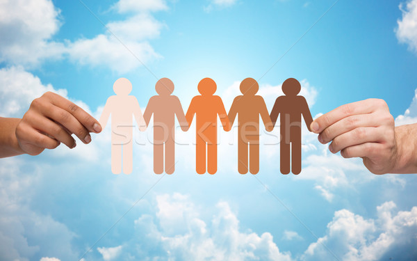 hands holding chain of people pictogram over sky Stock photo © dolgachov