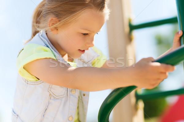 Felice bambina climbing bambini parco giochi estate Foto d'archivio © dolgachov