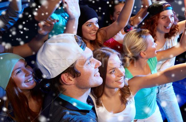 Souriant amis concert club fête vacances Photo stock © dolgachov