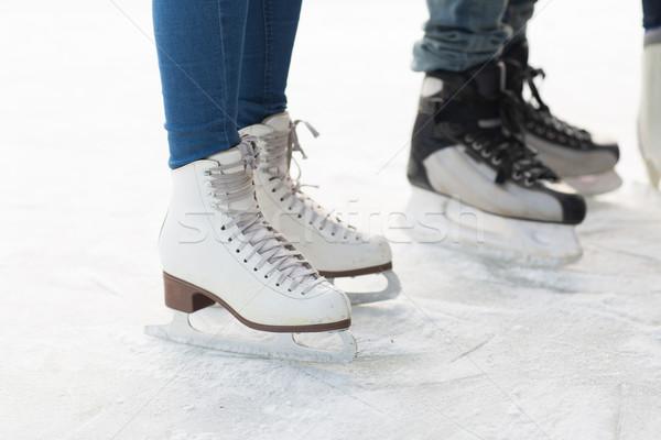 close up of legs in skates on skating rink Stock photo © dolgachov