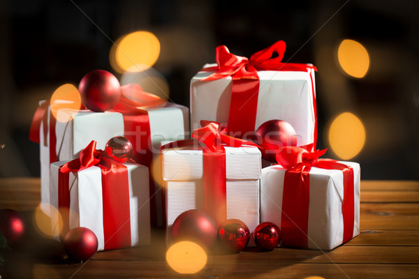 gift boxes and red christmas balls on wooden floor Stock photo © dolgachov