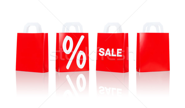 many red shopping bags with sale and percentage Stock photo © dolgachov