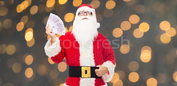 Férfi jelmez mikulás Euro pénz karácsony Stock fotó © dolgachov