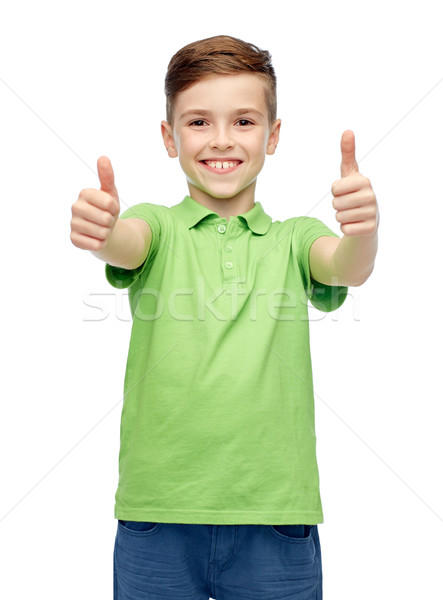 happy boy in green polo t-shirt showing thumbs up Stock photo © dolgachov