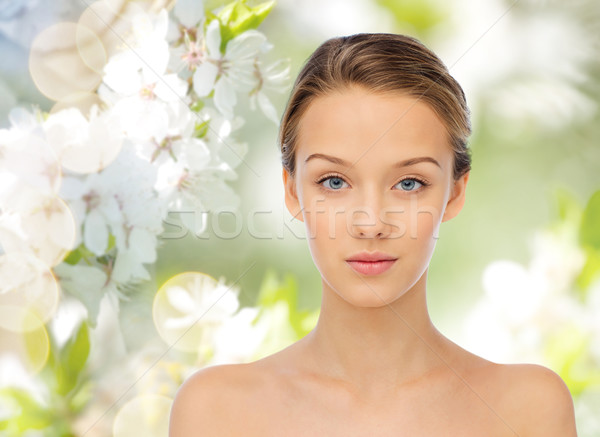 young woman face over cherry blossoms Stock photo © dolgachov