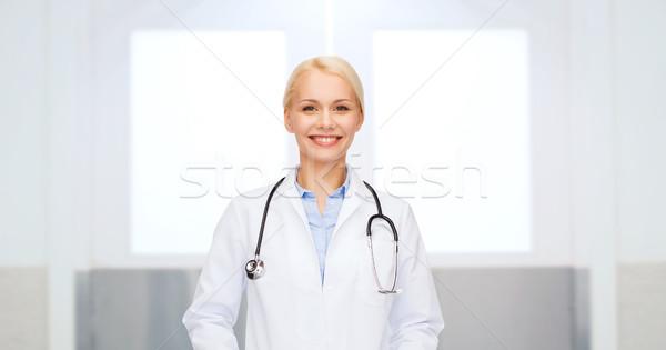 улыбаясь женщины врач белый пальто здравоохранения Сток-фото © dolgachov