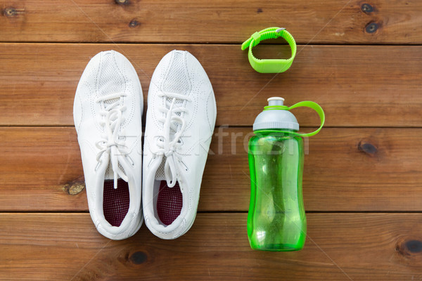 close up of sneakers, bracelet and water bottle Stock photo © dolgachov