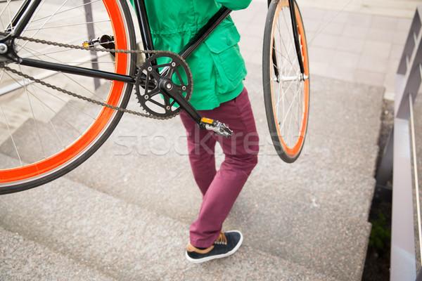 Férfi fix viselet bicikli emberek stílus Stock fotó © dolgachov