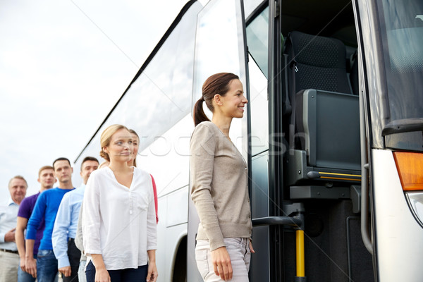 group of happy passengers boarding travel bus Stock photo © dolgachov