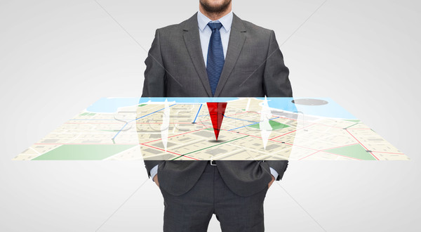 close up of businessman with gps navigator map Stock photo © dolgachov