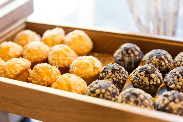 close up of sweets or muffins on wooden tray Stock photo © dolgachov