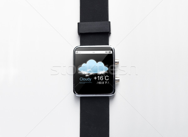 close up of smart watch with weather forecast app Stock photo © dolgachov